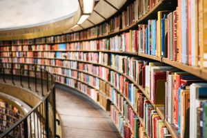 Curved library shelves full of books by Susan Yin on Unsplash